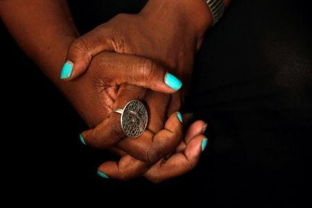 Tanya Walker, a 53-year-old transgender woman, activist and advocate, clinches her hand together during an interview at her apartment in New York City, U.S. September 7, 2016. Picture taken September 7, 2016. REUTERS/Brendan McDermid