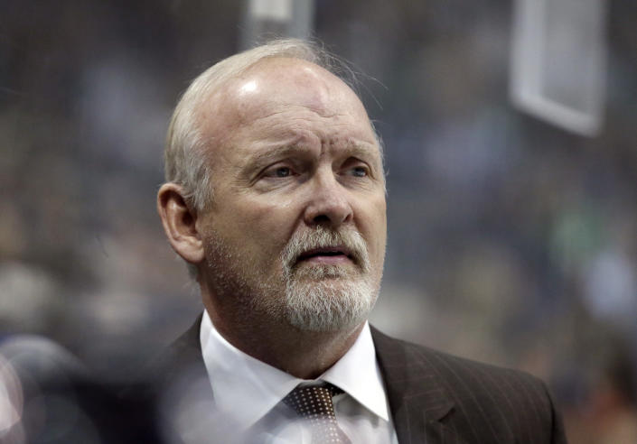 FILE - In this Jan. 14, 2017, file photo, then-Dallas Stars head coach Lindy Ruff watches play against the Minnesota Wild in the first period of an NHL hockey game in Dallas. Ruff is the head coach of the New Jersey Devils. (AP Photo/LM Otero, File)