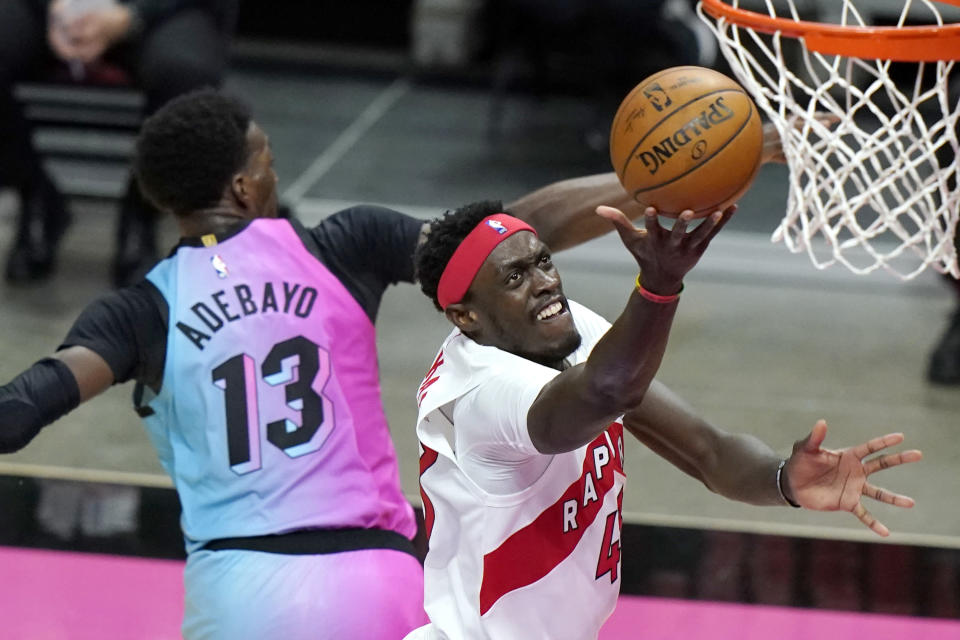Toronto Raptors forward Pascal Siakam, right, shoots over Miami Heat center Bam Adebayo (13) during the first half of an NBA basketball game, Wednesday, Feb. 24, 2021, in Miami. (AP Photo/Lynne Sladky)