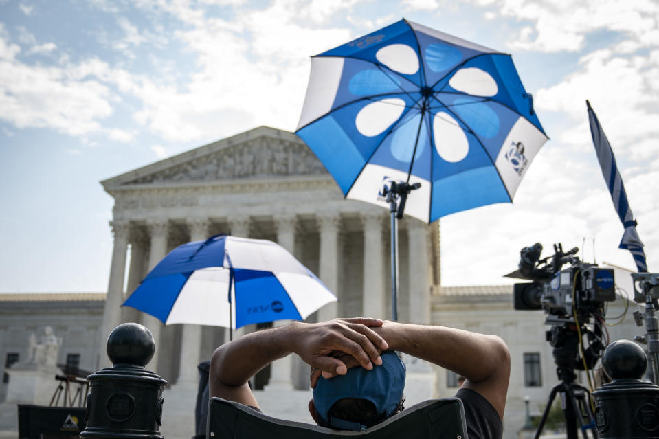 WASHINGTON, DC - JULY 06:  Members of the press work outside of the U.S. Supreme Court on July 6, 2020 in Washington, DC. The Supreme Court issued a unanimous opinion on Monday that says states can require Electoral College voters to back the winner of their states popular vote in a presidential election. The court also upheld a 1991 law that bars robocalls to cellphones. (Photo by Drew Angerer/Getty Images)