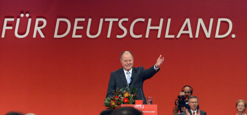 Peer Steinbrueck of the SPD , German Chancellor Angela Merkel's challenger for the next elections, delivers a speech during an extraordinary party convention of the German Social Democrats, SPD, in Hannover, northern Germany, Sunday, Dec. 9, 2012. The center-left Social Democrats held a special party convention to elect former Finance Minister Steinbrueck officially as their candidate to take on Merkel when Germans elect a new Parliament next fall. (AP Photo/dapd, Clemens Bilan)
