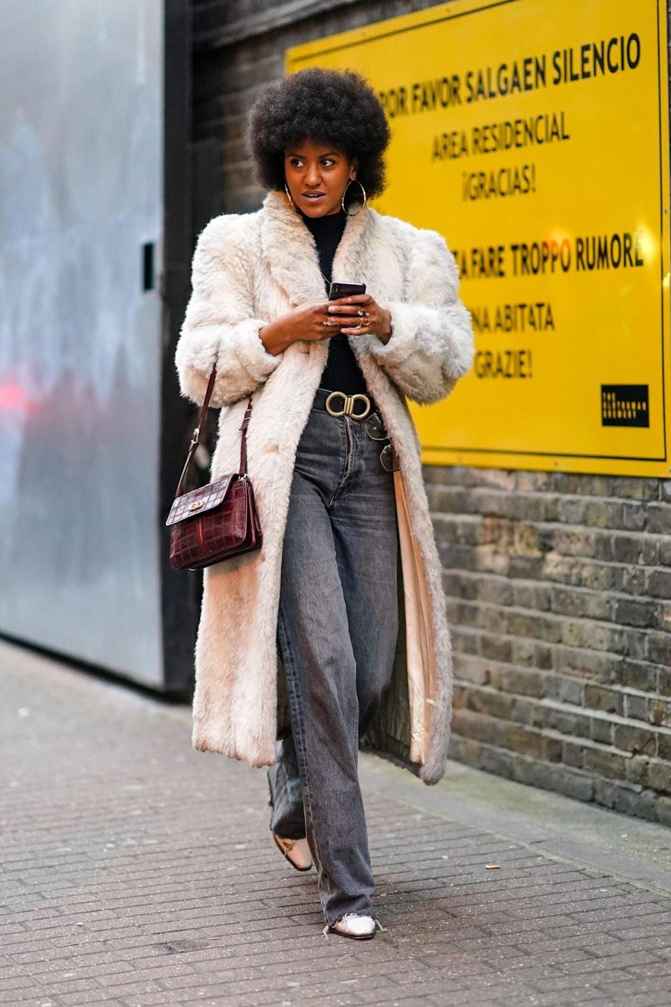 <p>An easy hack for making baggy jeans look polished? A belt! Heels and a structured bag help, too. </p>