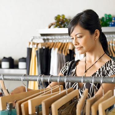 Young-woman-shopping-for-clothes-in-shop_web
