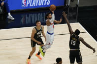 New York Knicks' Derrick Rose (4) shoots against Atlanta Hawks' Clint Capela (15) during the first half in Game 4 of an NBA basketball first-round playoff series Sunday, May 30, 2021, in Atlanta. (AP Photo/Brynn Anderson)