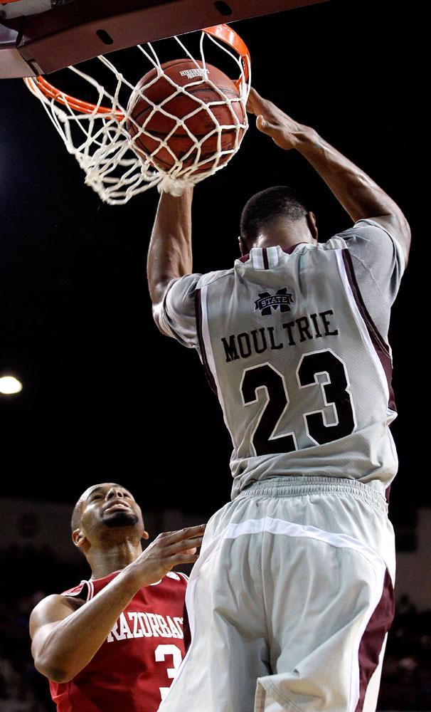 Mississippi State forward Arnett Moultrie (23) stretches for a backward dunk as Arkansas guard Rickey Scott (3) watches during the second half of their NCAA college basketball game, Saturday, March 3, 2012, in Starkville, Miss. Mississippi State won 79-59.