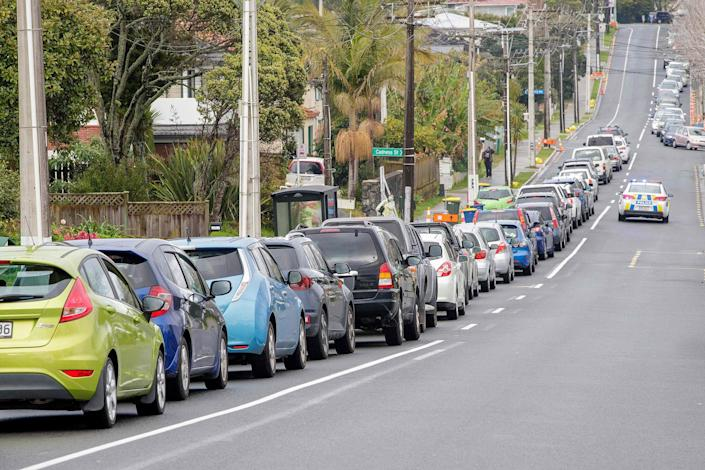 Image: Motorists queue at a COVID-19 coronavirus testing centre in the suburb of Northcote in Auckland, New Zealand (David Rowland / AFP - Getty Images)