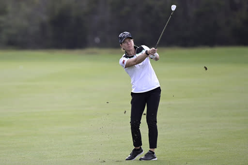Annika Sorenstam, of Sweden, watches after hitting from the 14th fairway during the first round of the PNC Championship golf tournament, Saturday, Dec. 19, 2020, in Orlando, Fla. Sorenstam is thinking of returning to limited competition next year in the U.S. Senior Women's Open. (AP Photo/Phelan M. Ebenhack)