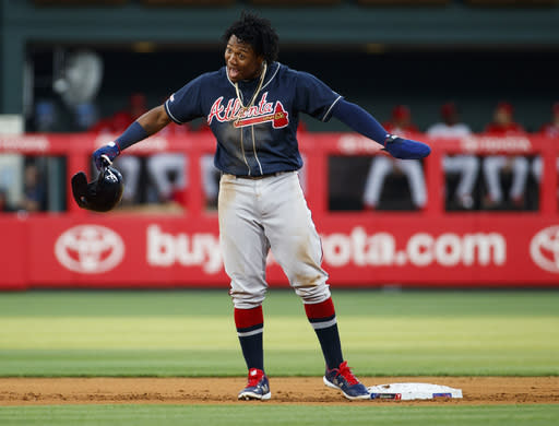 Atlanta Braves' Ronald Acuna Jr. reacts as he is called safe on a steal of second base by replay review during the first inning of a baseball game against the Philadelphia Phillies, Friday, July 26, 2019, in Philadelphia. (AP Photo/Chris Szagola)