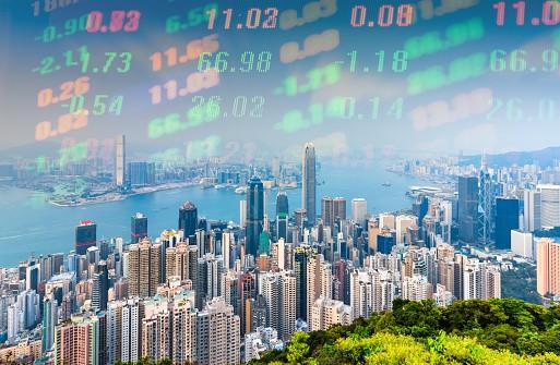 Hong Kong skyline during the day with financial numbers at top