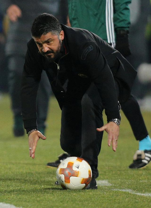 Soccer Football - Europa League Round of 32 First Leg - PFC Ludogorets Razgrad vs AC Milan - Ludogorets Arena, Razgrad, Bulgaria - February 15, 2018 AC Milan coach Gennaro Gattuso picks up the ball REUTERS/Stoyan Nenov