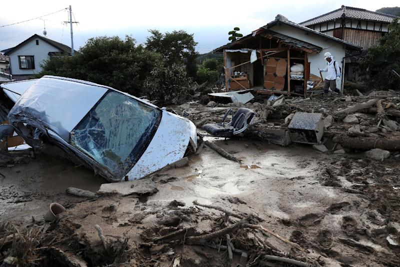 A vehicle is buried in mud one day after a landslide hit a residential area in Hiroshima, western Japan on August 21, 2014 (AFP Photo/Jiji Press)