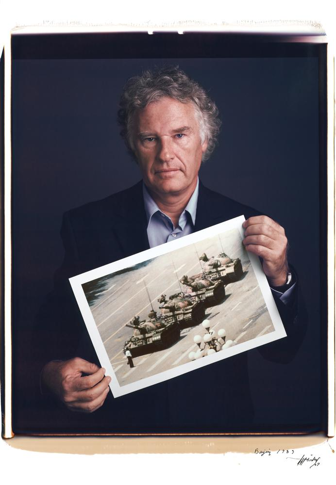 Jeff Widener holds his photo of Tank Man in Tienanmen Square from 1989. <br> <br> Photo: Tim Mantoani