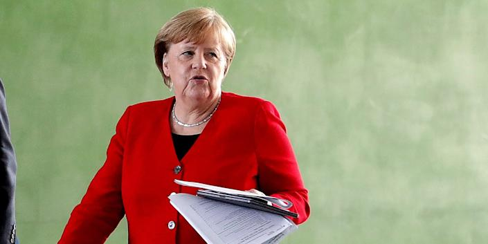 FILE PHOTO: German Chancellor Angela Merkel arrives at a news conference after an online meeting with German state governors on the loosening of the restrictions to reduce the spread of the coronavirus disease (COVID-19), in Berlin, Germany May 6, 2020. Michael Sohn/Pool via REUTERS