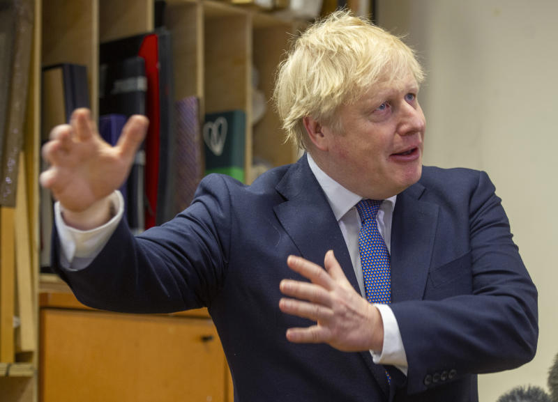 Britain's Prime Minister Boris Johnson gestures during a visit to the Connection, a homelessness centre, at St Martins in the Fields, London, Thursday, Feb. 27, 2020. (Tim Clarke/Pool Photo via AP)