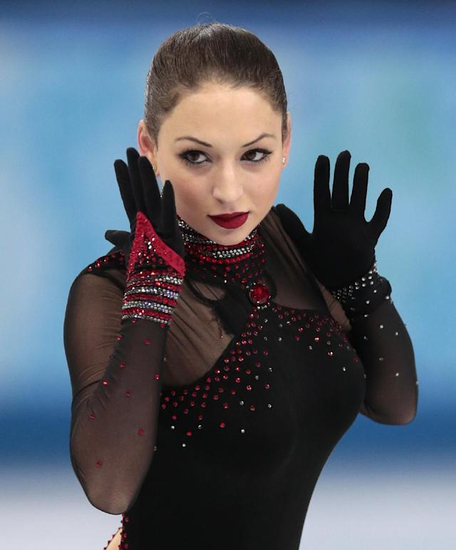 Elene Gedevanishvili of Georgia competes in the women's short program figure skating competition at the Iceberg Skating Palace during the 2014 Winter Olympics, Wednesday, Feb. 19, 2014, in Sochi, Russia. (AP Photo/Ivan Sekretarev)