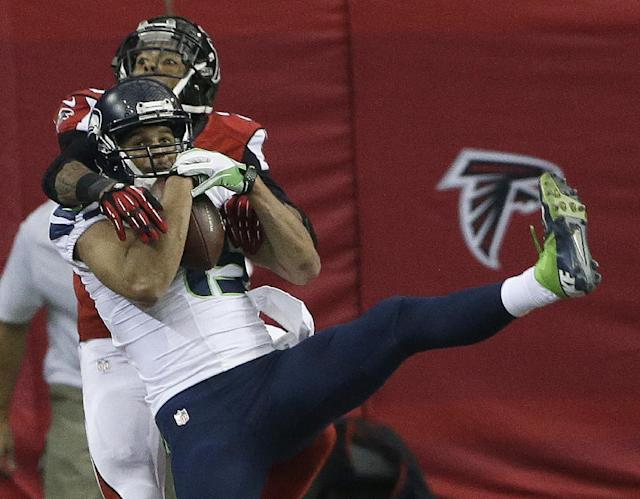 Seattle Seahawks wide receiver Jermaine Kearse (15) makes a touch-down catch against Atlanta Falcons free safety Thomas DeCoud (28) during the first half of an NFL football game, Sunday, Nov. 10, 2013, in Atlanta. (AP Photo/John Bazemore)