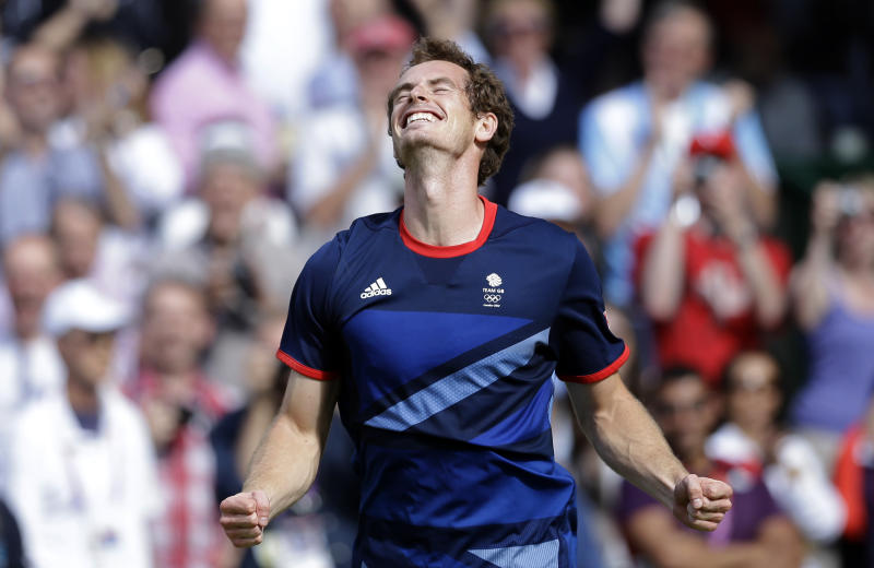 Britain's Andy Murray celebrates after defeating Switzerland's Roger Federer to win the men's singles gold medal match at the All England Lawn Tennis Club at Wimbledon, in London, at the 2012 Summer Olympics, Sunday, Aug. 5, 2012. (AP Photo/Victor R. Caivano)
