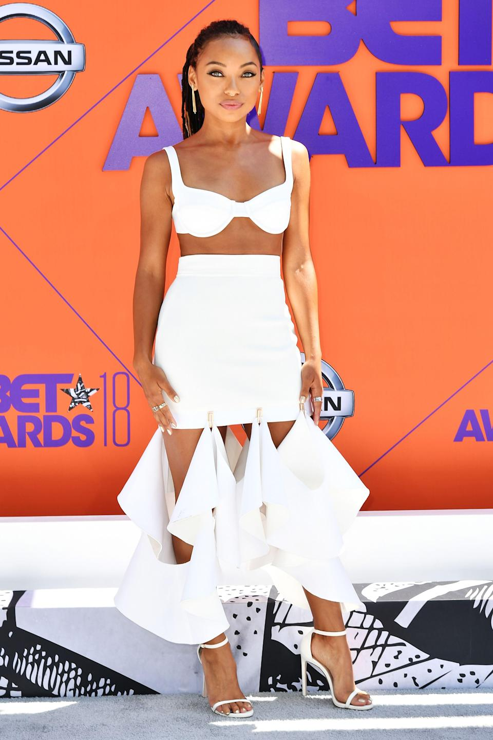 "<p>Logan Browning is beating the heat in a white bra top and a far-from-average-pencil-skirt combo by Dion Lee.</p><span class=""copyright"">Photo: Earl Gibson III/Getty Images.</span>"