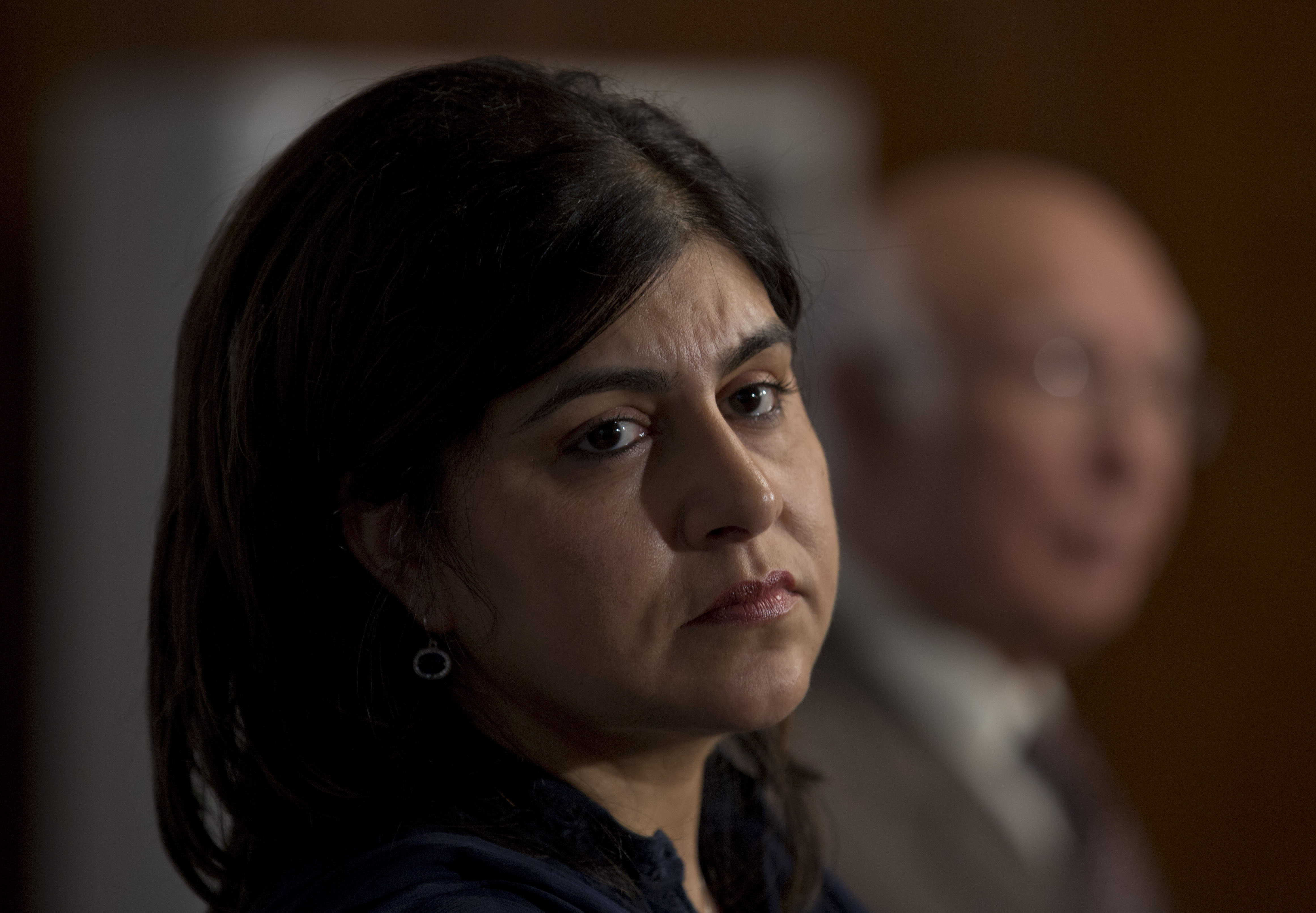 Baroness Sayeeda Warsi, British senior minister of state at the Foreign and Commonwealth Office, listens to a reporter during a joint news conference with Sartaj Aziz in Islamabad, Pakistan, Thursday, Oct. 3, 2013. Warsi met Pakistani officials and leadership to discus various bilateral, regional and international issues. (AP Photo/B.K. Bangash)
