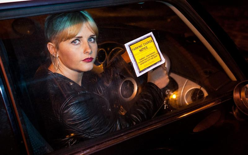 CarlyMackie, 28, parked outside her mother's home and ignored the almost-daily parking charge notices on her windscreen - Steve MacDougall / SWNS.com