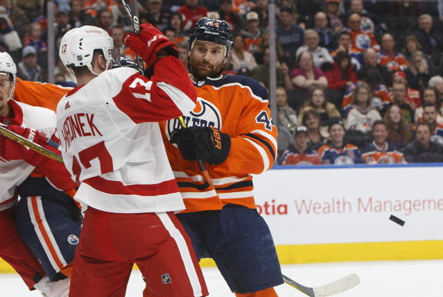 Detroit Red Wings' Filip Hronek (17) and Edmonton Oilers' Zack Kassian (44) battle in front of the net during second period NHL action in Edmonton on Tuesday, Jan. 22, 2019. (Jason Franson/The Canadian Press via AP)