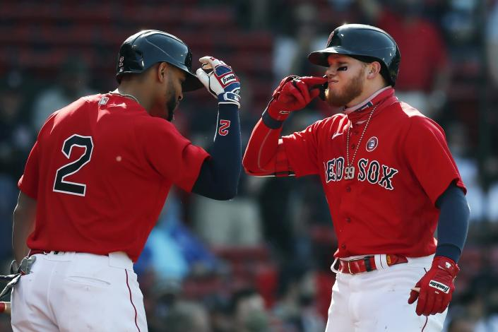 Boston Red Sox's Alex Verdugo celebrates his solo home run with Xander Bogaerts (2) during the first inning of a baseball game against the Los Angeles Angels, Saturday, May 15, 2021, in Boston. (AP Photo/Michael Dwyer)