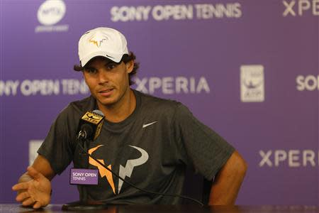 Mar 28, 2014; Miami, FL, USA; Rafael Nadal speaks with the media after an announcement that Tomas Berdych (not pictured) withdrew from his match against Nadal in a men's semi final of the Sony Open at Crandon Tennis Center. Geoff Burke-USA TODAY Sports