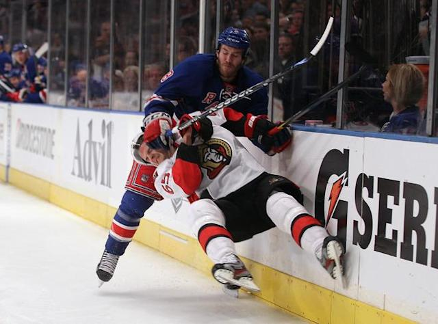 NEW YORK, NY - APRIL 14: Erik Karlsson #65 of the Ottawa Senators is checked by Brandon Prust #8 of the New York Rangers in Game Two of the Eastern Conference Quarterfinals during the 2012 NHL Stanley Cup Playoffs at Madison Square Garden on April 14, 2012 in New York City. (Photo by Bruce Bennett/Getty Images)