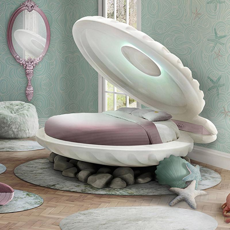 You Can Live Out Your Little Mermaid Fantasies With This Shell-Shaped Bed