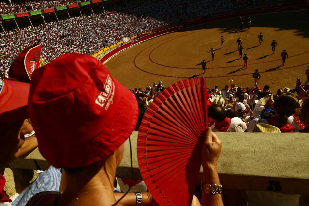 <p>Bullfighters make the 'paseillo' or ritual entrance to the arena before a bullfight at the San Fermin festival in Pamplona, Spain, July 11, 2017. (Photo: Alvaro Barrientos/AP) </p>