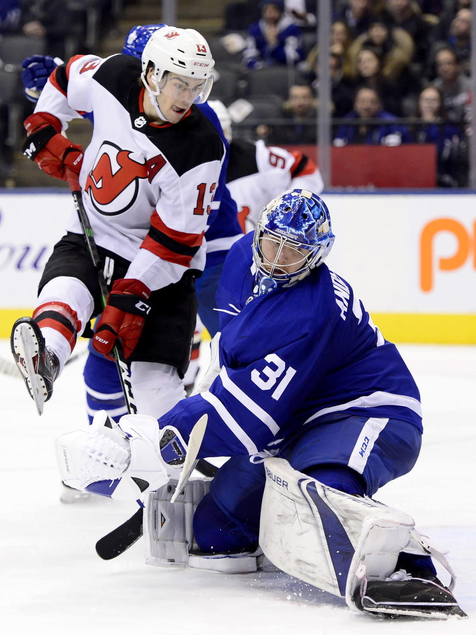 Toronto Maple Leafs goaltender Frederik Andersen (31) looks back as the puck goes in, next to New Jersey Devils center Nico Hischier (13) during the third period of an NHL hockey game Tuesday, Jan. 14, 2020, in Toronto. (Frank Gunn/The Canadian Press via AP)
