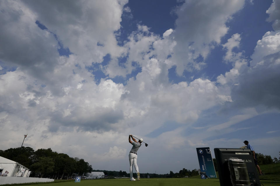 Rory McIlroy, of Northern Ireland, tees off on the 12th hole during the first round of the BMW Championship golf tournament, Thursday, Aug. 26, 2021, at Caves Valley Golf Club in Owings Mills, Md. (AP Photo/Julio Cortez)