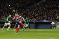 Atletico Madrid's Kieran Trippier misses a penalty kick during the Champions League Group D soccer match between Atletico Madrid and Lokomotiv Moscow at Wanda Metropolitano stadium in Madrid, Spain, Wednesday, Dec. 11, 2019. (AP Photo/Manu Fernandez)