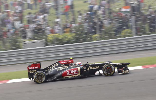 Lotus F1 Formula One driver Romain Grosjean of France drives during the Indian F1 Grand Prix at the Buddh International Circuit in Greater Noida, on the outskirts of New Delhi, October 27, 2013. REUTERS/Ahmad Masood (INDIA - Tags: SPORT MOTORSPORT F1)