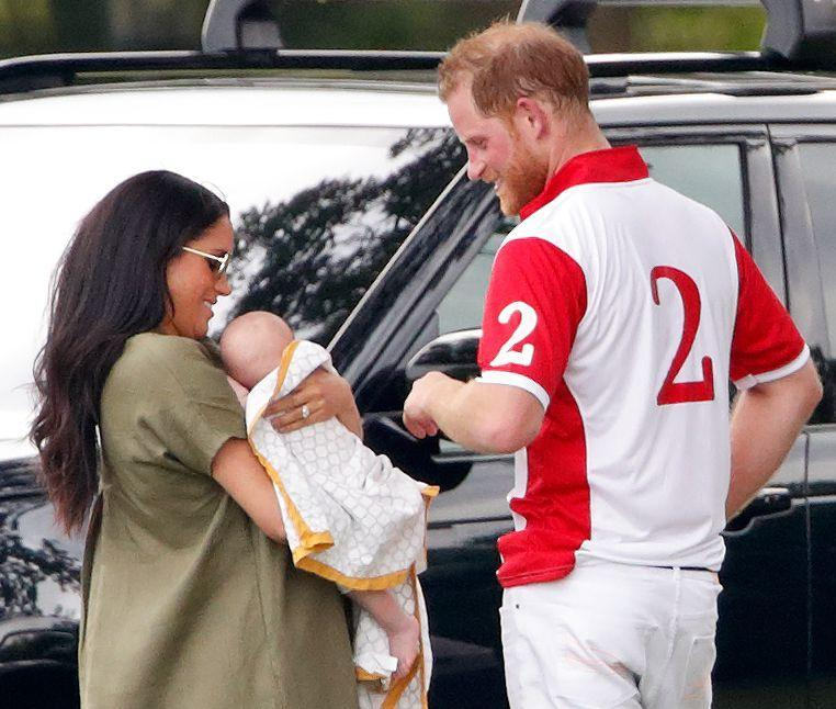 <p>The mother and newborn watched on as Prince Harry competed in the Khun Vichai Srivaddhanaprabha Memorial Polo Trophy at Billingbear Polo Club on 10 July in Wokingham. Following the game, Prince Harry could be seen looking at his son affectionately. </p>