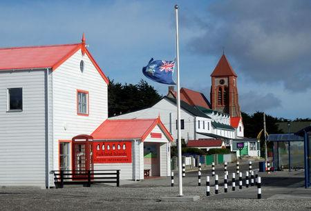 FILE PHOTO: The Falkland Islands flag flies at half mast in front of the Visitor Centre after the death of former British prime minister Margaret Thatcher, in Port Stanley, April 8, 2013. REUTERS/Gary Clement/File Photo