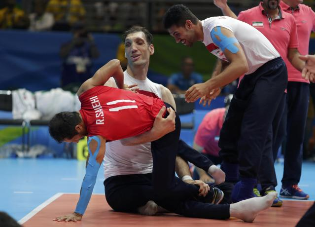 2016 Rio Paralympics - Sitting Volleyball - Final - Men's Gold Medal Match - Riocentro Pavilion 6 - Rio de Janeiro, Brazil - 18/09/2016. Morteza Mehrzadselakjani and Ramezan Salehihajikolaei (IRI) of Iran celebrate. REUTERS/Ueslei Marcelino FOR EDITORIAL USE ONLY. NOT FOR SALE FOR MARKETING OR ADVERTISING CAMPAIGNS.