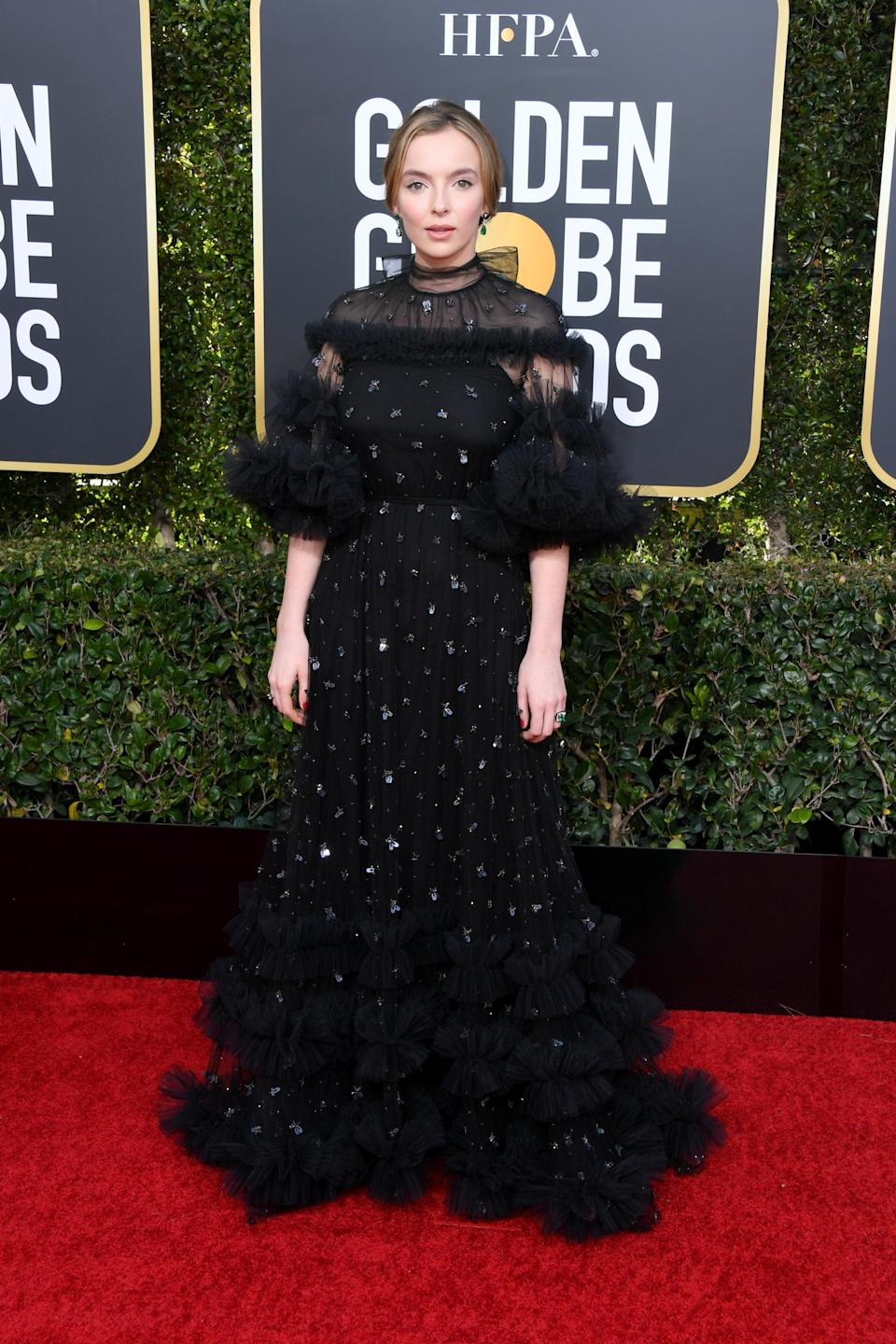 <p>Jodie Comer chose a ruffled Ralph and Russo dress Villanelle would be proud of for this year's Golden Globe Awards. <em>[Photo: Getty]</em> </p>
