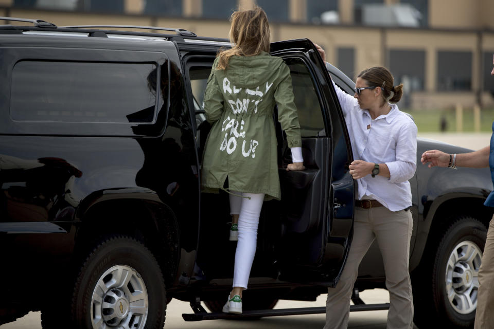 """First lady Melania Trump arrived at Andrews Air Force Base after visiting the Upbring New Hope Children Center for migrant children wearing a khaki jacket reading the slogan """"I don't really care. Do u?"""". Undertsandably, the jacket was seen as tone-deaf and backlash ensued online. [Photo: AP/Andrew Harnik]"""