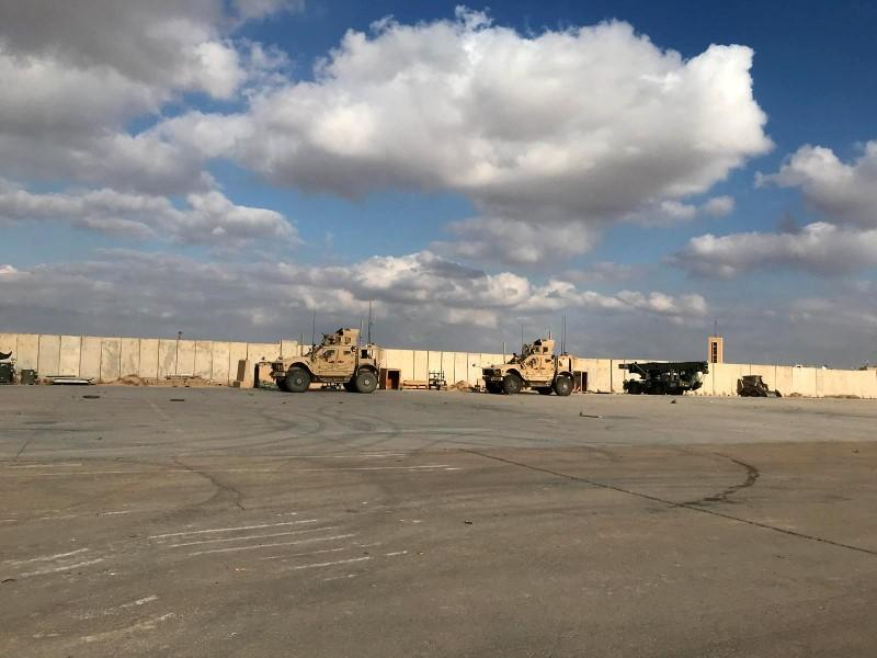 Military vehicles of U.S. soldiers are seen at Ain al-Asad air base in Anbar province