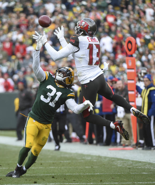 <p>Green Bay Packers cornerback Davon House (31) breaks up a pass intended for Tampa Bay Buccaneers wide receiver Mike Evans (13) in the second quarter at Lambeau Field. Mandatory Credit: Benny Sieu-USA TODAY Sports </p>