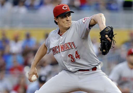 Cincinnati Reds pitcher Homer Bailey throws in the first inning during a baseball game against the Miami Marlins in Miami, Tuesday, May 14, 2013. (AP Photo/Lynne Sladky)