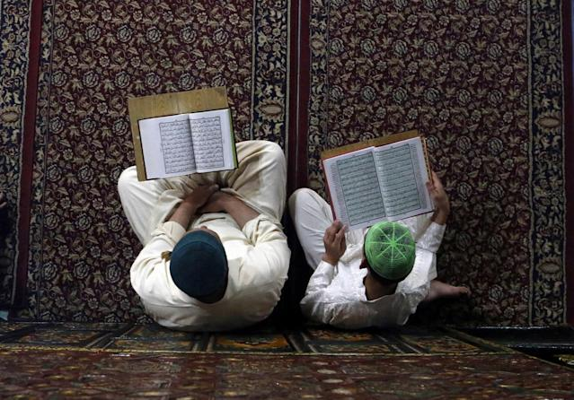 <p>Kashmiri Muslims read verses from the Quran, Islam's holy book, inside the shrine of Shah-e-Hamdan during the holy month of Ramadan in Srinagar, Kashmir, May 29, 2017. (AP Photo/Mukhtar Khan) </p>