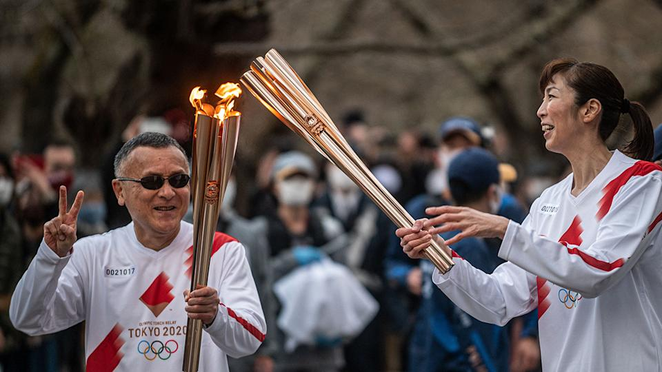 The Olympic torch relay began in March, with the Tokyo Games set to begin on July 23. (Photo by Philip FONG / AFP) (Photo by PHILIP FONG/AFP via Getty Images)