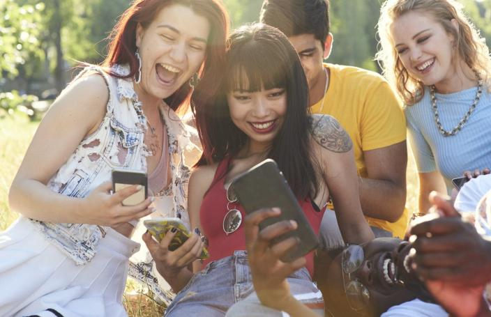 "<span class=""caption"">Teens and young adults spend several hours a day looking at their phones and watching videos, many of which might contain product placements for vaping.</span> <span class=""attribution""><a class=""link rapid-noclick-resp"" href=""https://www.gettyimages.com/detail/photo/group-of-friends-having-fun-royalty-free-image/1138899799?adppopup=true"" rel=""nofollow noopener"" target=""_blank"" data-ylk=""slk:Flashpop/Getty Images"">Flashpop/Getty Images</a></span>"