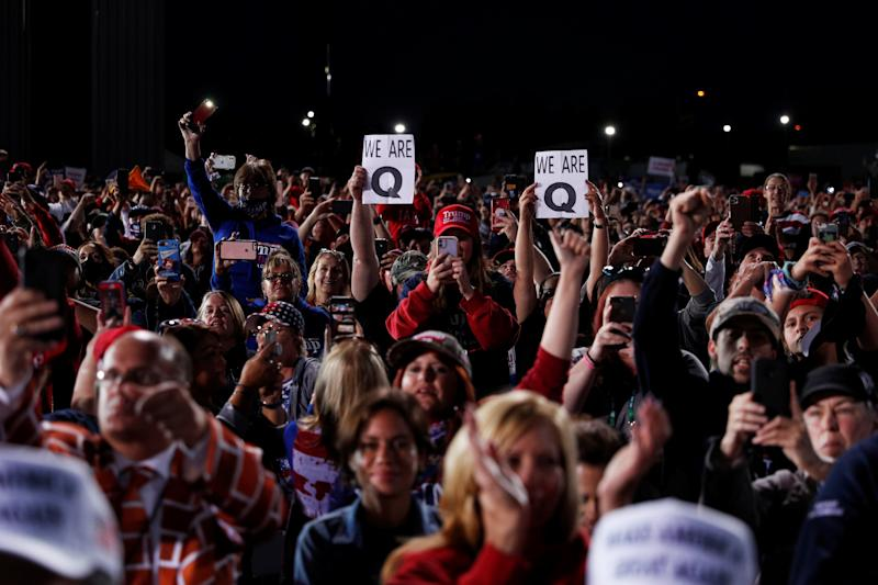 People holding QAnon signs attend a campaign rally with U.S. President Donald Trump in Moon Township, Pennsylvania, U.S., September 22, 2020. REUTERS/Tom Brenner