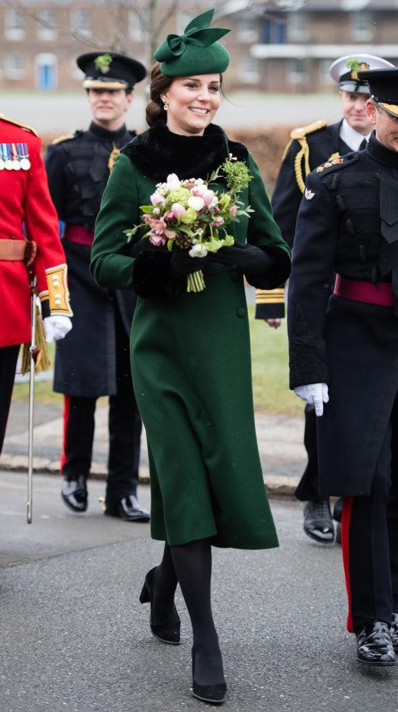 <p>For the annual Irish Guards St Patrick's Day Parade, the Duchess of Cambridge dressed her blossoming baby bump in emerald green. The 36-year-old chose a Catherine Walker coat accessorised with faux fur cuffs and collar by Gina Foster which she first donned back in 2013. <em>[Photo: Getty]</em> </p>