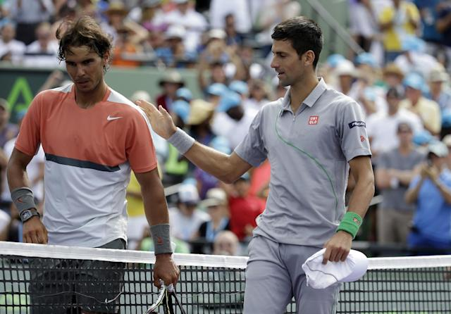 Rafael Nadal, of Spain, left, meets Novak Djokovic, of Serbia, right, at the net after Djokovic defeated Nadal 6-3, 6-3 during the men's final at the Sony Open Tennis tournament, Sunday, March 30, 2014, in Key Biscayne, Fla. (AP Photo/Lynne Sladky)