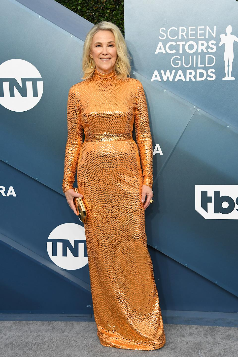 O'Hara sported one of the biggest trends of awards season wither her orange belted gown by Marc Jacobs and metallic accessories.
