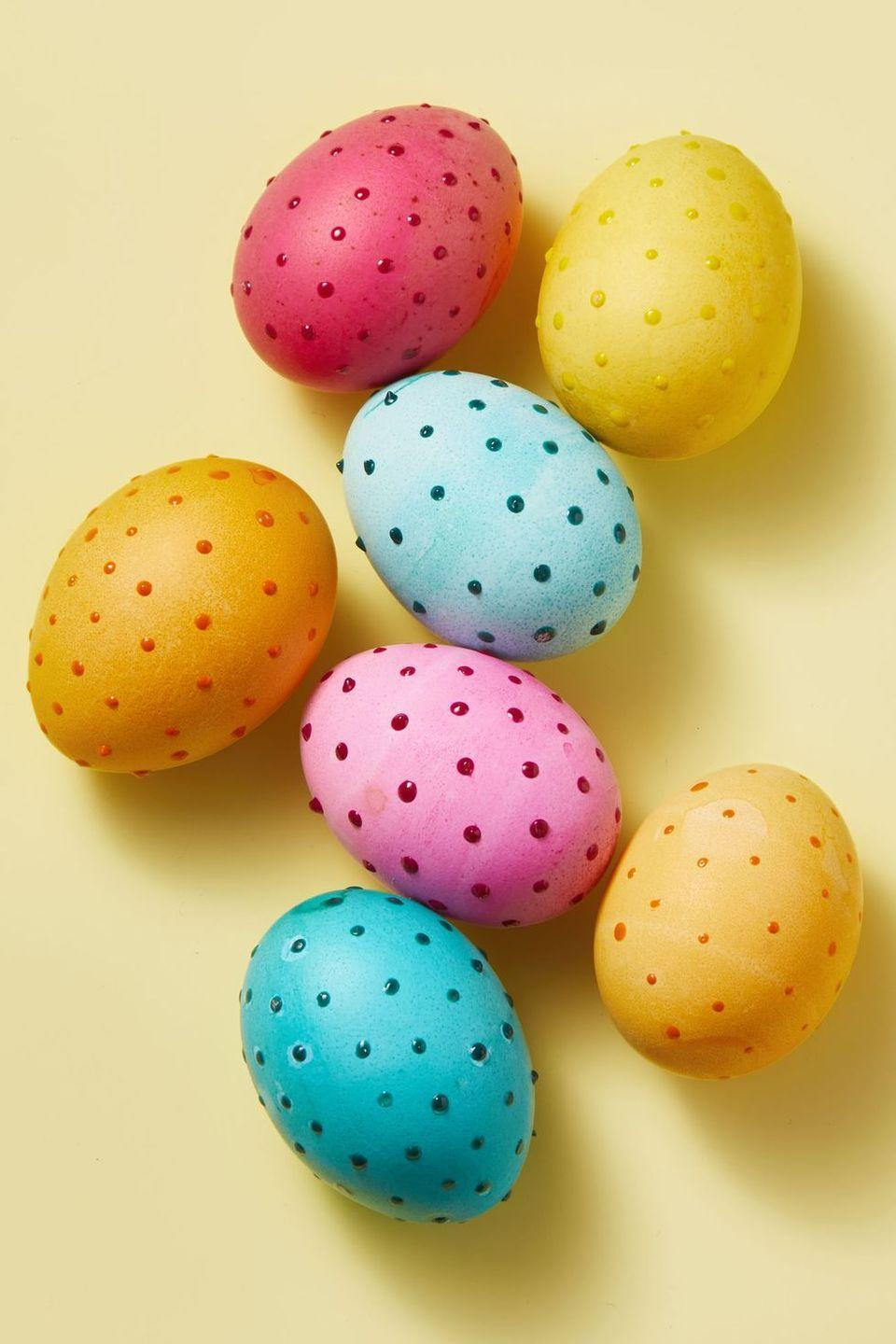 """<p>You can either use a traditional Easter egg dying technique or paint for the background color. But when it's time to add the dots, you'll want to invest in <a href=""""https://www.amazon.com/Tulip-Dimensional-Fabric-Paint-Puffy/dp/B000ILZAWY?tag=syn-yahoo-20&ascsubtag=%5Bartid%7C10055.g.35814277%5Bsrc%7Cyahoo-us"""" rel=""""nofollow noopener"""" target=""""_blank"""" data-ylk=""""slk:puff paint"""" class=""""link rapid-noclick-resp"""">puff paint</a> for a 3D effect. </p>"""